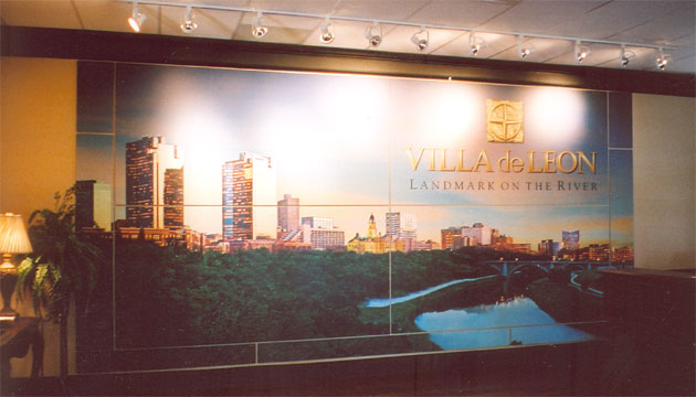 Large photograph of downtown Fort Worth, Texas mounted on the wall of a sales office