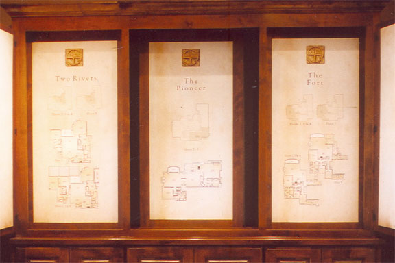 House floorplans printed with a parchment background and mounted in a custom cabinet