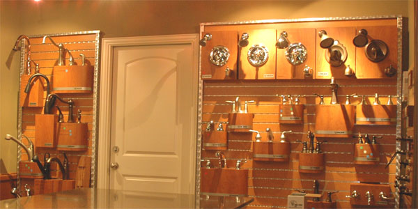 A wall covered in faucet examples in the Landstar Homes showroom