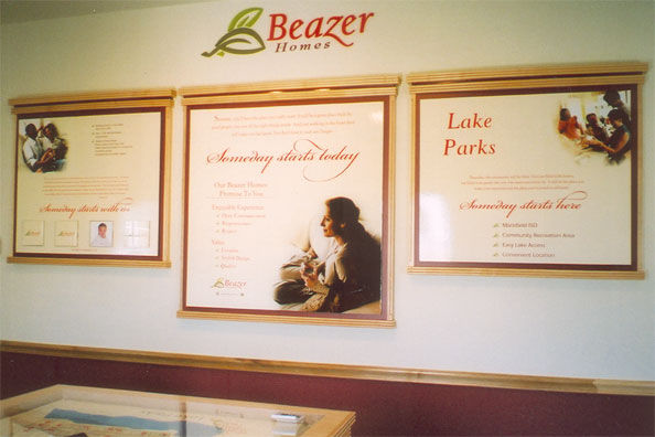 Three framed wall displays in a Beazer Homes sales office