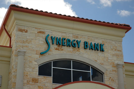 Illuminated letters mounted on the exterior of a bank