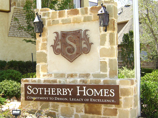 Sotherby Homes monument sign with a rusted steel plate and shield-shaped logo