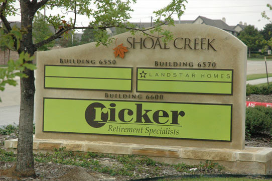 Shoal Creek tenant monument sign with three tenants listed in large green boxes