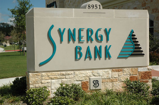 Synergy Bank simple white stone monument